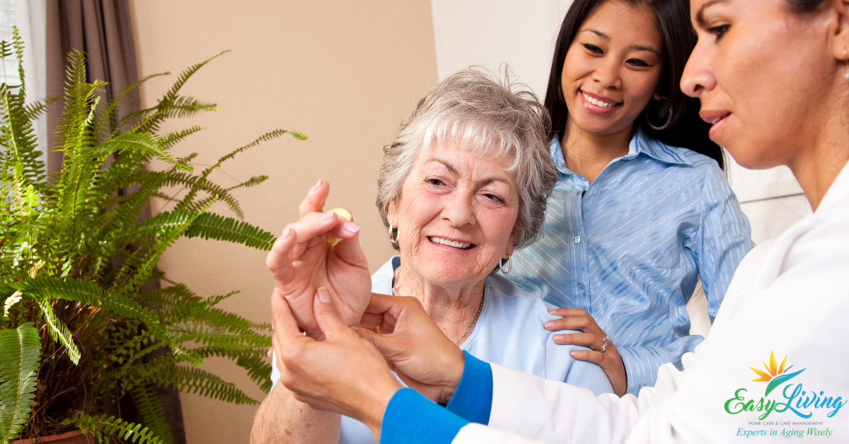 home health care PT working with home care worker and client